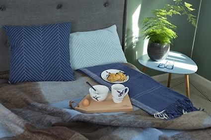blauw slaapkamer kussens plaids