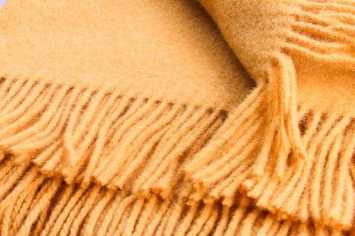 okergele plaid wol effen