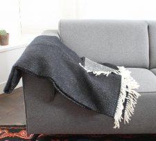 plaid zwart lamswol klippan