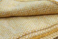 gele plaid klippan lamswol domino