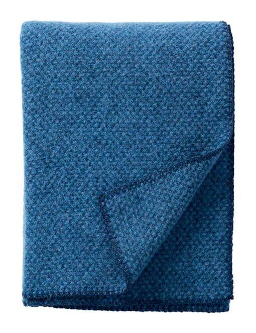 plaid blauw lamswol klippan domino